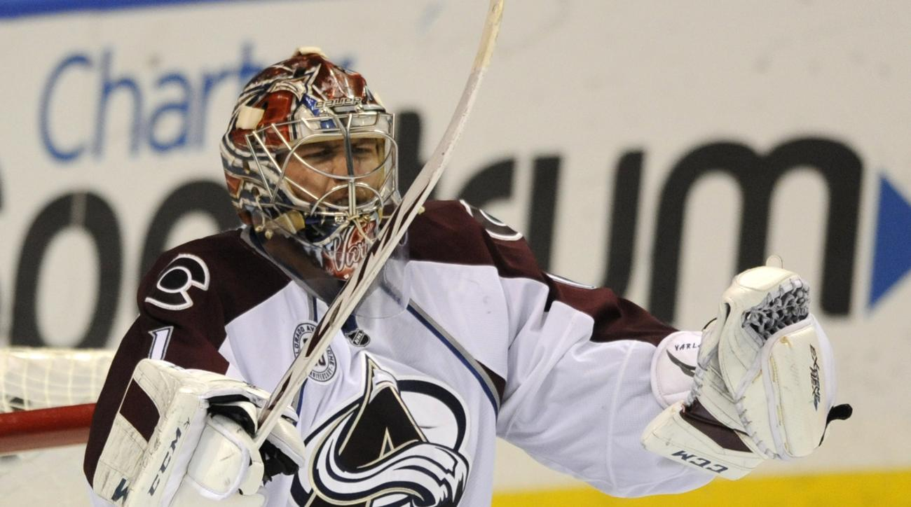 Colorado Avalanche goalie Semyon Varlamov (1), of Russia, celebrates his team's 3-1 victory over the St. Louis Blues in an NHL hockey game, Sunday, Dec. 13, 2015, in St. Louis. (AP Photo/Bill Boyce)