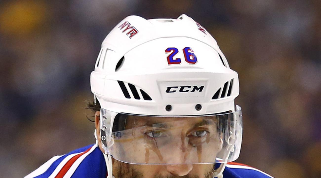 FILE - In this Sept. 24, 2015, file photo, New York Rangers' Jarret Stoll is shown during the third period of the of an NHL preseason hockey game against the New York Rangers in Boston. The 33-year-old center pleaded guilty in June to two reduced misdemea