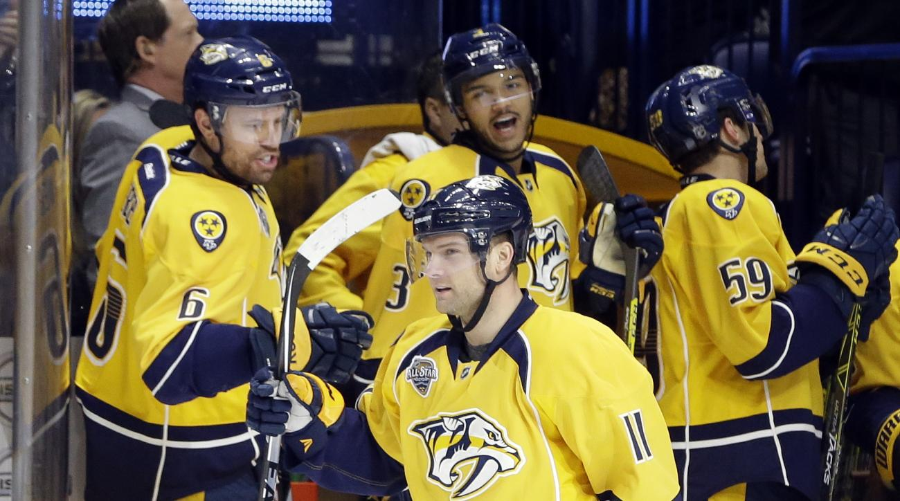 Nashville Predators center Cody Hodgson (11) is congratulated by Shea Weber (6) and Seth Jones (3) after Hodgson scored a goal on a penalty shot against the Calgary Flames during the first period of an NHL hockey game Tuesday, Dec. 15, 2015, in Nashville,