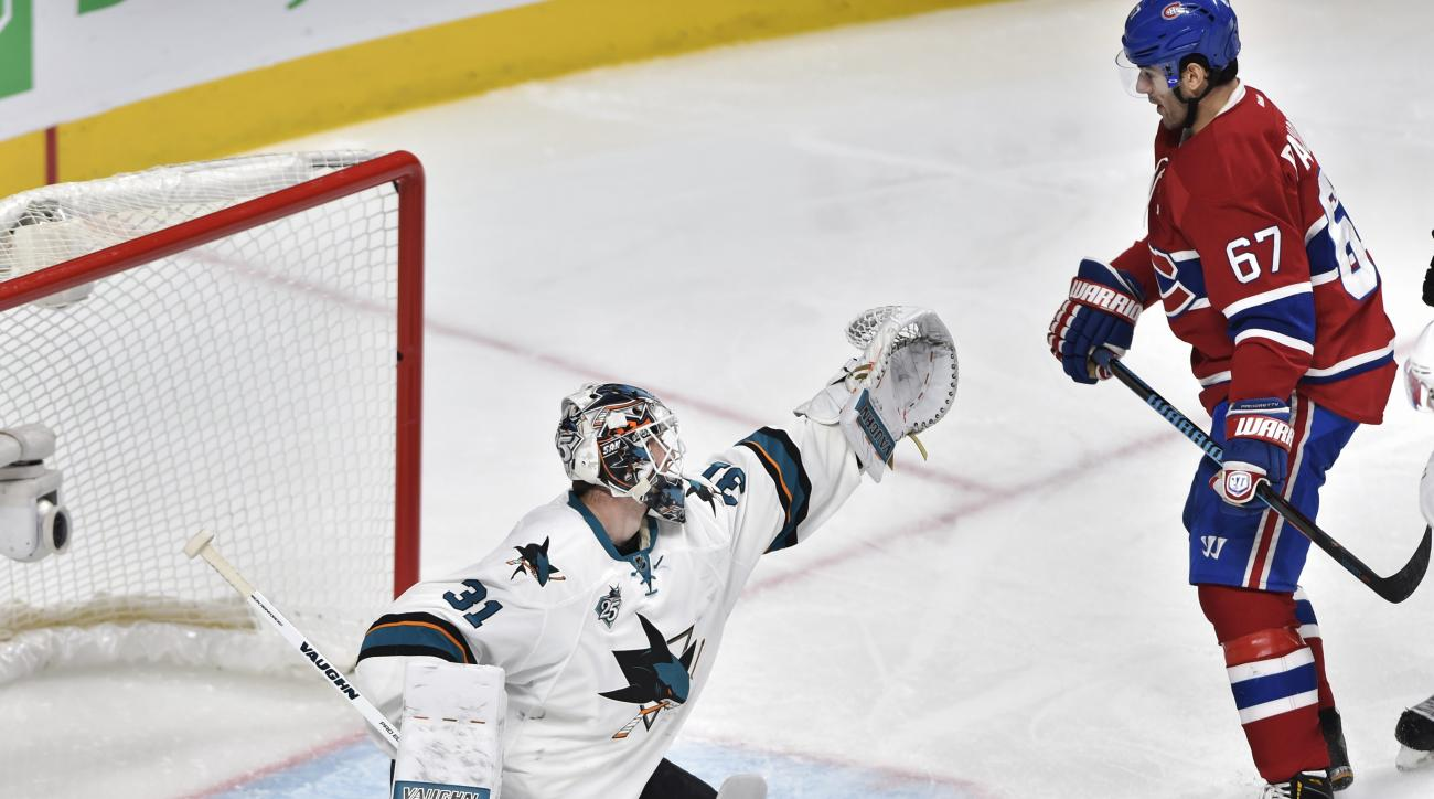 San Jose Sharks goalie Martin Jones (31) makes a save in front of Montreal Canadiens left wing Max Pacioretty (67) during the third period of an NHL hockey game Tuesday, Dec. 15, 2015, in Montreal. (Ryan Remiorz/The Canadian Press via AP)