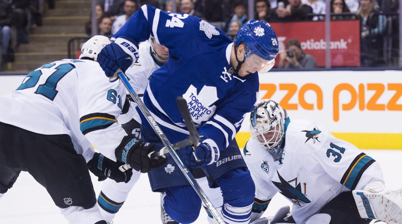 San Jose Sharks goalie Martin Jones (31) makes a save against Toronto Maple Leafs center Peter Holland (24) during the second period of an NHL hockey game Thursday, Dec. 17, 2015, in Toronto. (Nathan Denette/The Canadian Press via AP)