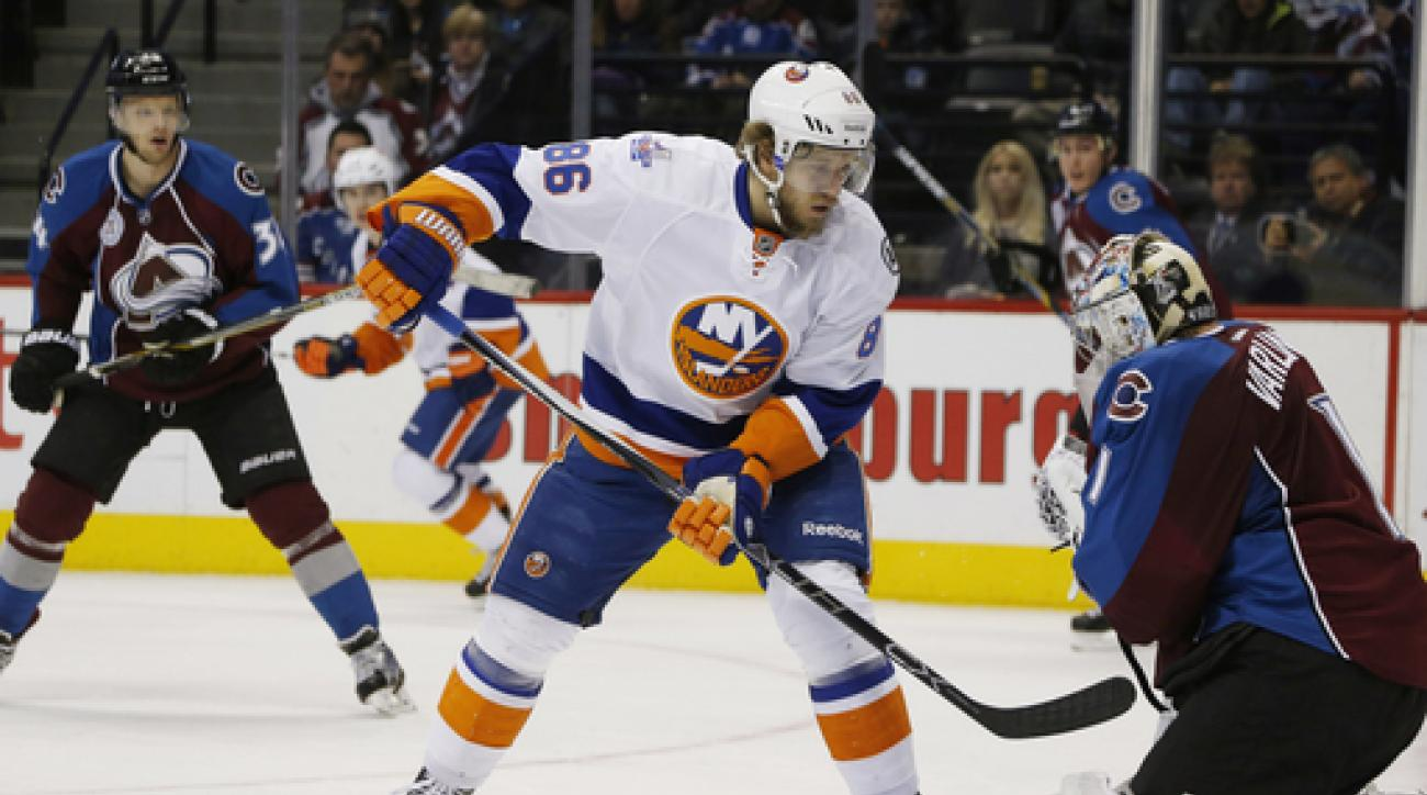 New York Islanders left wing Nikolay Kulemin, of Russia, redirects a puck to Colorado Avalanche goalie Semyon Varlamov, of Russia, in the first period of an NHL hockey game, Thursday, Dec. 17, 2015, in Denver. (AP Photo/David Zalubowski)