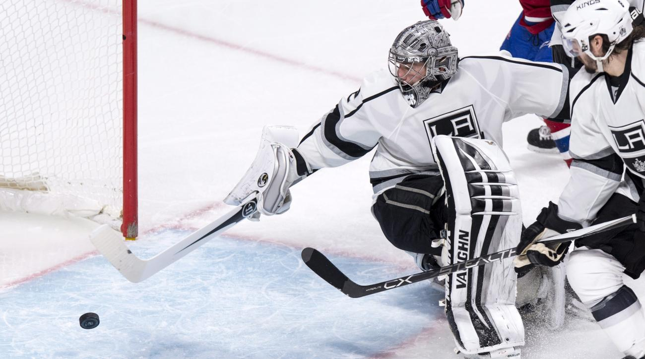 Los Angeles Kings' goalie Jonathan Quick reaches back to stop a puck as they face the Montreal Canadiens during third period NHL hockey action in Montreal, on Thursday, Dec. 17, 2015. Quick shut out the Canadians 3-0. (Paul Chiasson/The Canadian Press via