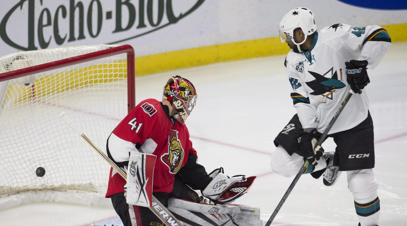 San Jose Sharks right wing Joel Ward, right, screens Ottawa Senators goalie Craig Anderson, left, as a shot from Joe Thornton scores during second-period NHL hockey game action Friday, Dec. 18, 2015, in Ottawa, Ontario. (Adrian Wyld/The Canadian Press via