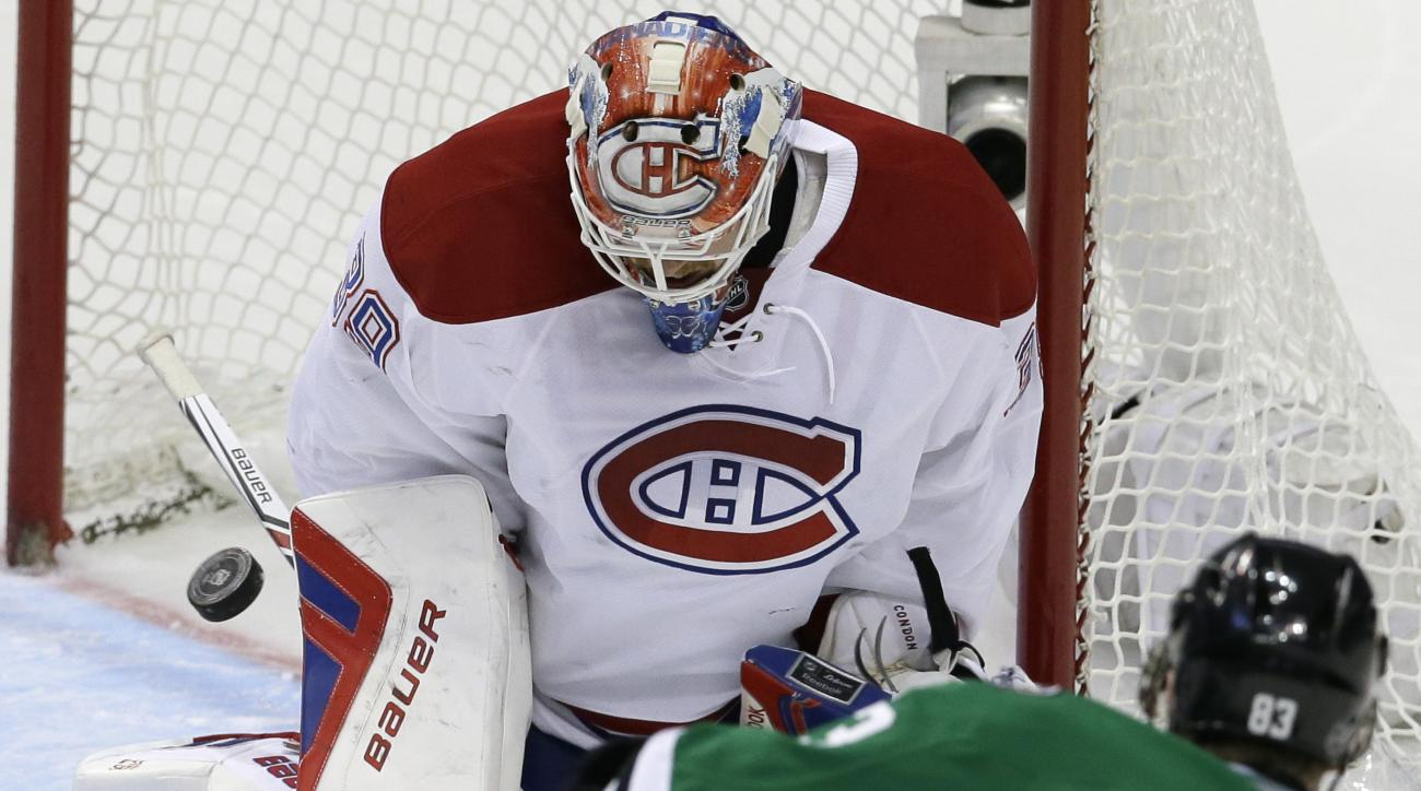 Montreal Canadiens goalie Mike Condon (39) blocks a shot against Dallas Stars right wing Ales Hemsky (83) during the second period of an NHL hockey game Saturday, Dec. 19, 2015, in Dallas. (AP Photo/LM Otero)