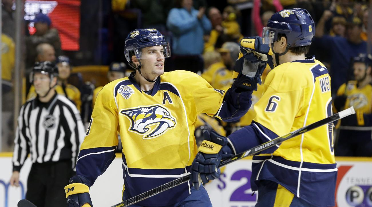 Nashville Predators defenseman Roman Josi, of Switzerland, is congratulated by Shea Weber (6) after Josi scored a goal against the Montreal Canadiens during the second period of an NHL hockey game Monday, Dec. 21, 2015, in Nashville, Tenn. (AP Photo/Mark