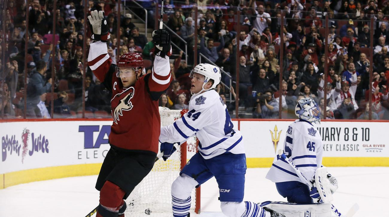 Arizona Coyotes' Shane Doan, left, celebrates his goal against Toronto Maple Leafs' Jonathan Bernier (45) during the first period of an NHL hockey game as Maple Leafs' Morgan Rielly (44) skates by Tuesday, Dec. 22, 2015, in Glendale, Ariz. (AP Photo/Ross