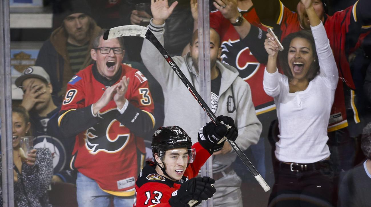 Calgary Flames' Johnny Gaudreau celebrates his third goal during third period of an NHL hockey game in Calgary, Alberta, Tuesday, Dec. 22, 2015. (Jeff McIntosh/The Canadian Press via AP) MANDATORY CREDIT