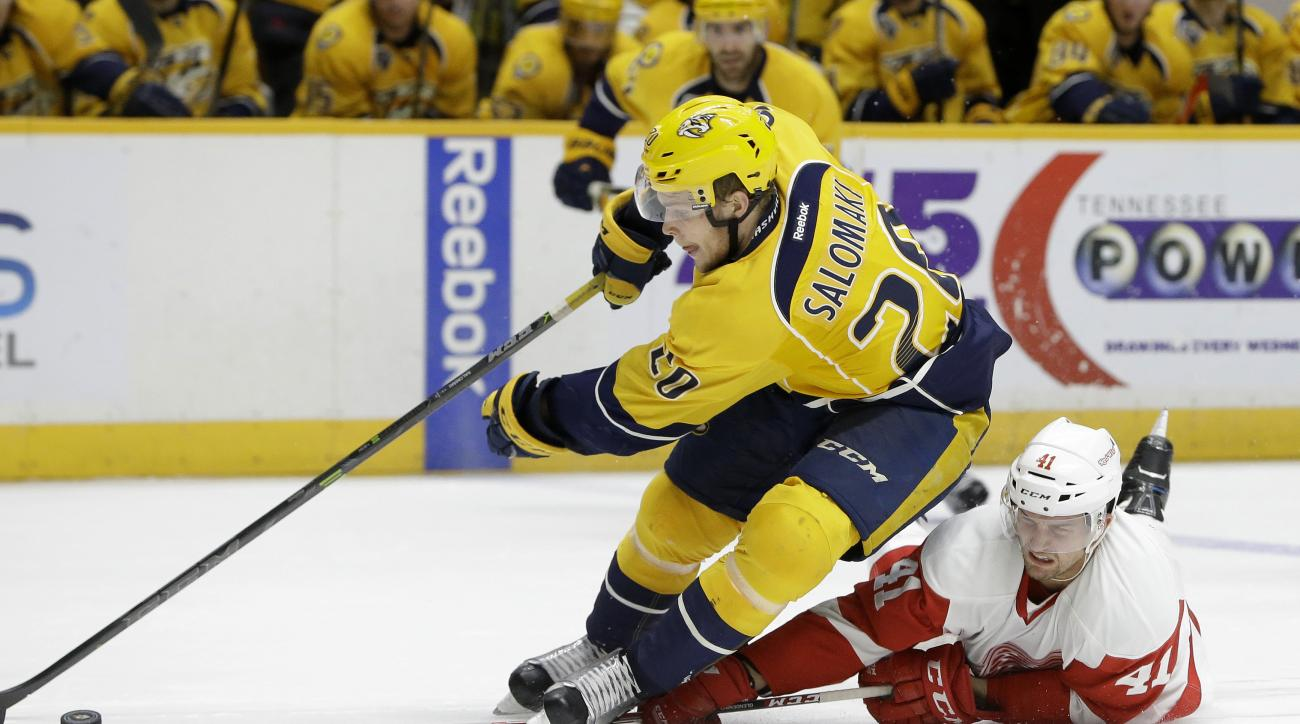 Detroit Red Wings center Luke Glendening (41) defends Nashville Predators forward Miikka Salomaki (20) during the second period of an NHL hockey game Saturday, Dec. 26, 2015, in Nashville, Tenn. Glendening was called for tripping on the play. (AP Photo/Ma