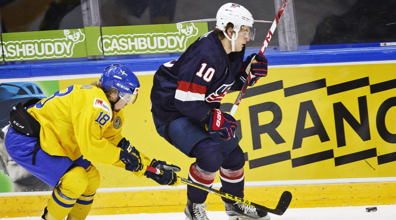 Alexander Nylander of Sweden, left, vies for the puck with Anders Bjork of the USA , during the 2016 World Junior Hockey Championship match between Sweden and USA in Helsinki, Finland, Monday, Dec. 28, 2015.  (Roni Rekomaa /Lehtikuva via AP) FINLAND OUT