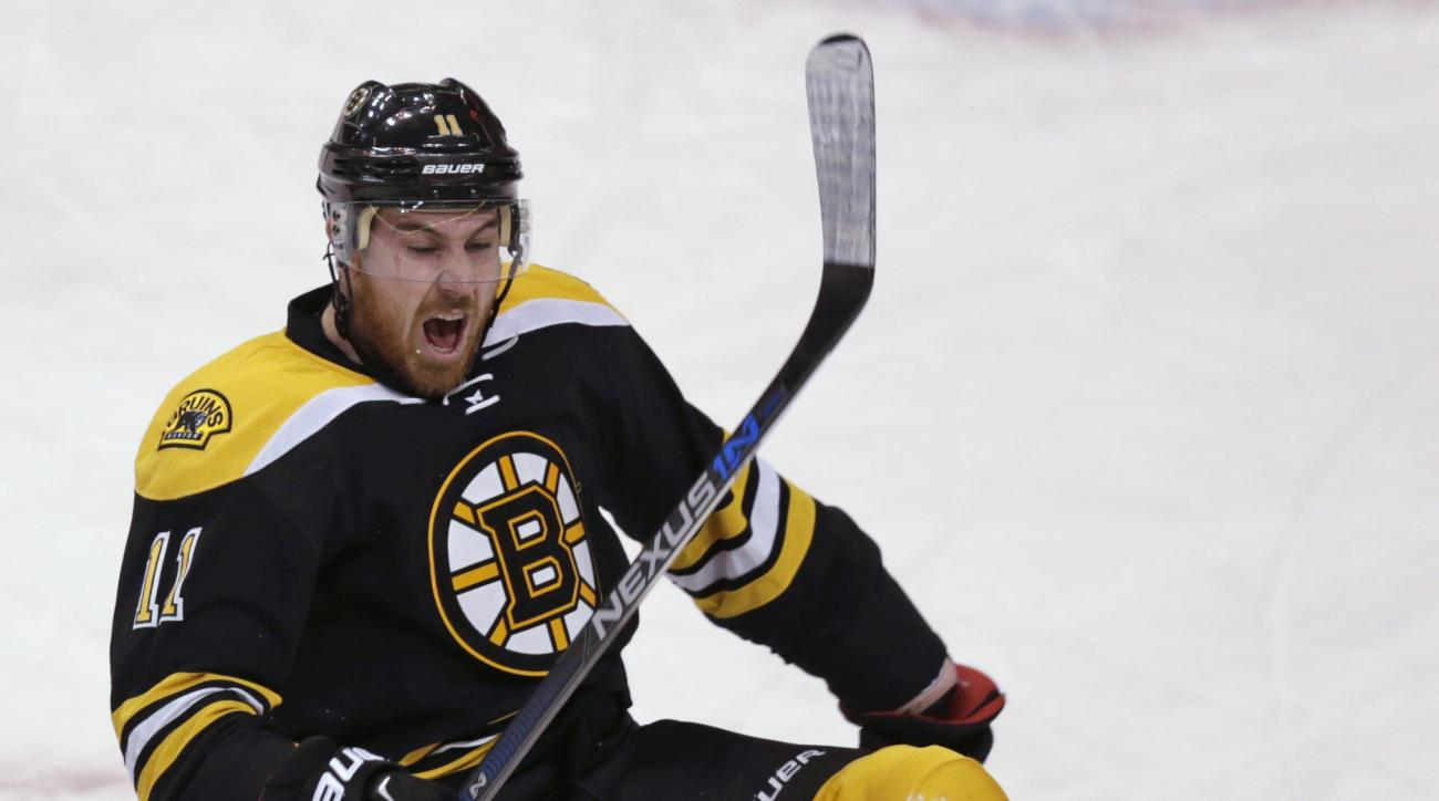 Boston Bruins right wing Jimmy Hayes (11) celebrates after his goal against Ottawa Senators goalie Craig Anderson during the first period of an NHL hockey game in Boston, Tuesday, Dec. 29, 2015. (AP Photo/Charles Krupa)