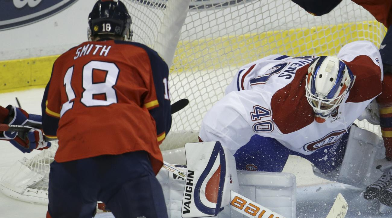 Montreal Canadiens goalie Ben Scrivens (40) makes a save on a goal attempt by Florida Panthers right wing Reilly Smith (18) during the third period of an NHL hockey game, Tuesday, Dec. 29, 2015, in Sunrise, Fla. The Panthers defeated the Canadiens 3-1. (A
