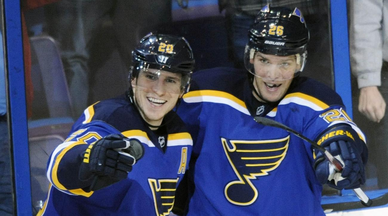 St. Louis Blues' Alexander Steen (20) celebrates his game-winning goal in overtime with Paul Stastny (26) against the Nashville Predators in an NHL hockey game, Tuesday, Dec. 29, 2015, in St. Louis. (AP Photo/Bill Boyce)