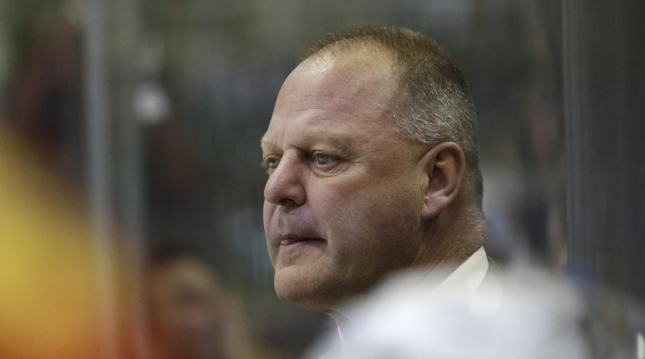 Florida Panthers head coach Gerard Gallant looks on from the bench during the first period of an NHL hockey game against the Dallas Stars Saturday, Oct. 24, 2015, in Dallas. (AP Photo/LM Otero)