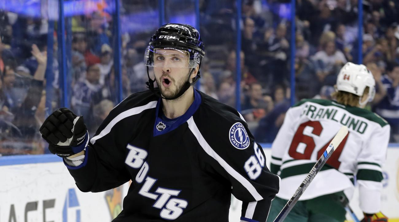 Tampa Bay Lightning right wing Nikita Kucherov (86), of Russia, pumps his fist after scoring against the Minnesota Wild during the second period of an NHL hockey game Saturday, Jan. 2, 2016, in Tampa, Fla. (AP Photo/Chris O'Meara)