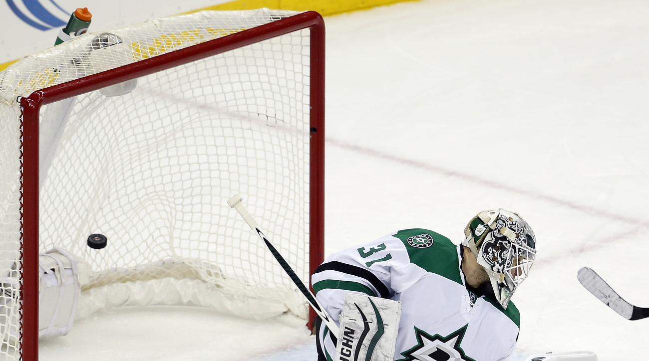 A shot by New Jersey Devils defenseman John Moore, not pictured, enters the net after getting passed Dallas Stars goalie Antti Niemi, of Finland, during overtime in an NHL hockey game, Saturday, Jan. 2, 2016, in Newark, N.J. The Devils won 3-2 in overtime