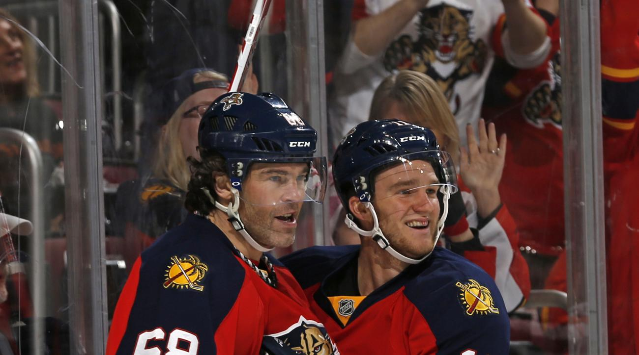 Florida Panthers forward Jaromir Jagr (68) is congratulated by forward Jonathan Huberdeau (11) after he scored a goal against the Minnesota Wild during the first period of an NHL hockey game, Sunday, Jan. 3, 2016, in Sunrise, Fla. (AP Photo/Joel Auerbach)
