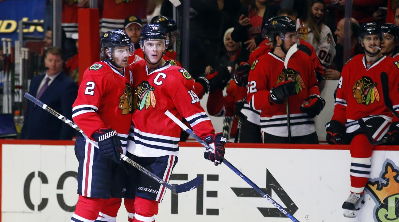 Chicago Blackhawks defenseman Duncan Keith (2) celebrates his goal with teammate center Jonathan Toews (19) during the second period of an NHL hockey game against the Ottawa Senators Sunday, Jan. 3, 2016, in Chicago. (AP Photo/Jeff Haynes)