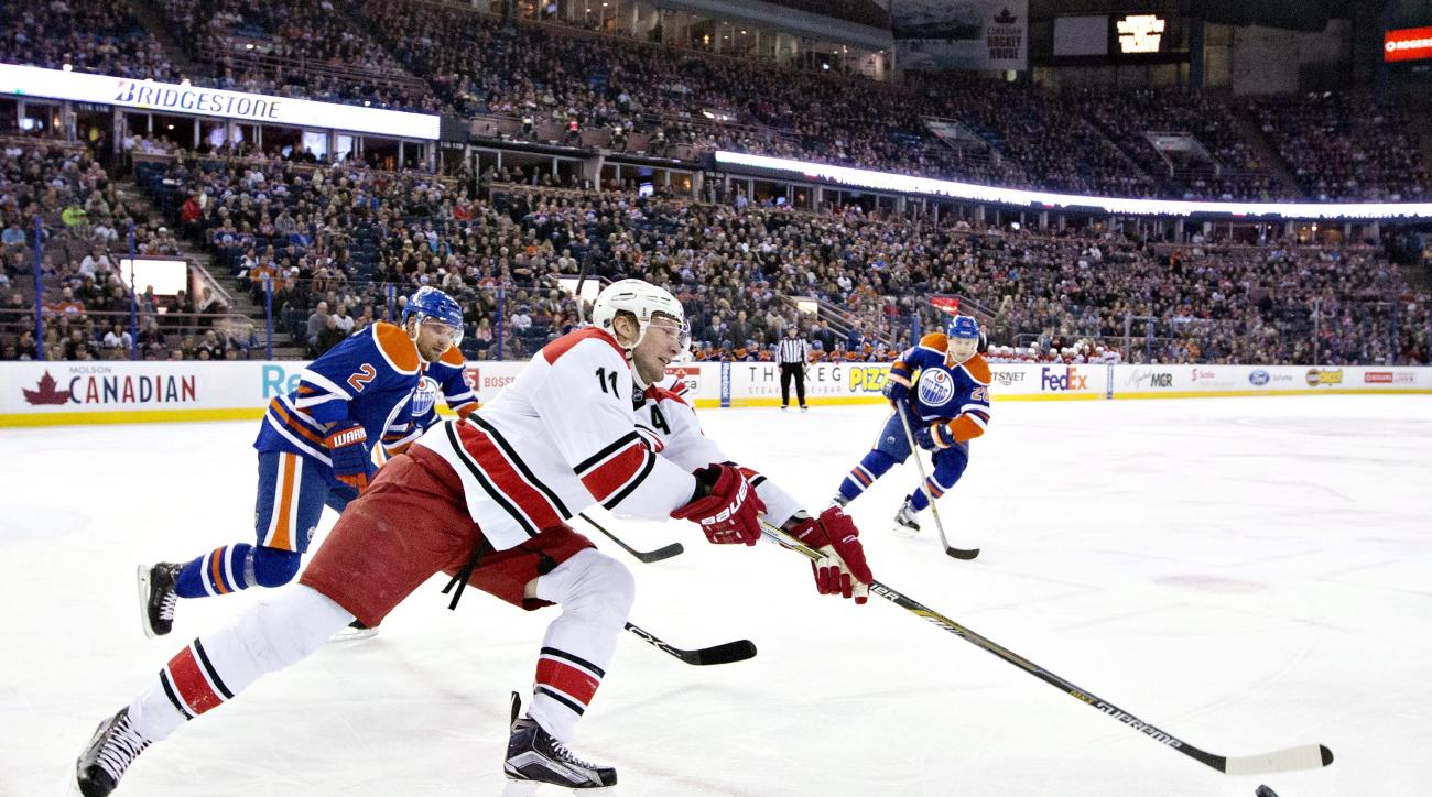 Carolina Hurricanes' Jordan Staal (11) is chased by Edmonton Oilers' Andrej Sekera (2) during first period NHL hockey action in Edmonton, Alberta, Sunday, Jan. 4, 2016. (AP Photo/The Canadian Press, Jason Franson)