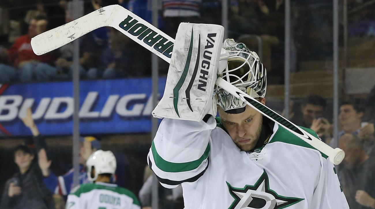 Dallas Stars goalie Antti Niemi (31) replaces his mask after the New York Rangers scored a goal during the second period of an NHL hockey game, Tuesday, Jan. 5, 2016, in New York.  (AP Photo/Julie Jacobson)