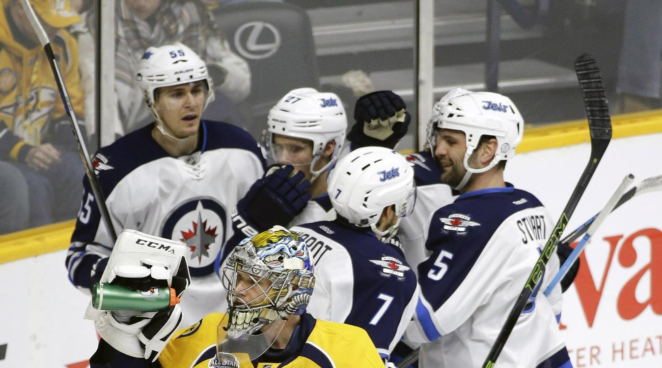 Nashville Predators goalie Pekka Rinne (35), of Finland, takes a drink as Winnipeg Jets defenseman Ben Chiarot (7) celebrates a goal in the third period of an NHL hockey game Tuesday, Jan. 5, 2016, in Nashville, Tenn. (AP Photo/Mark Humphrey)
