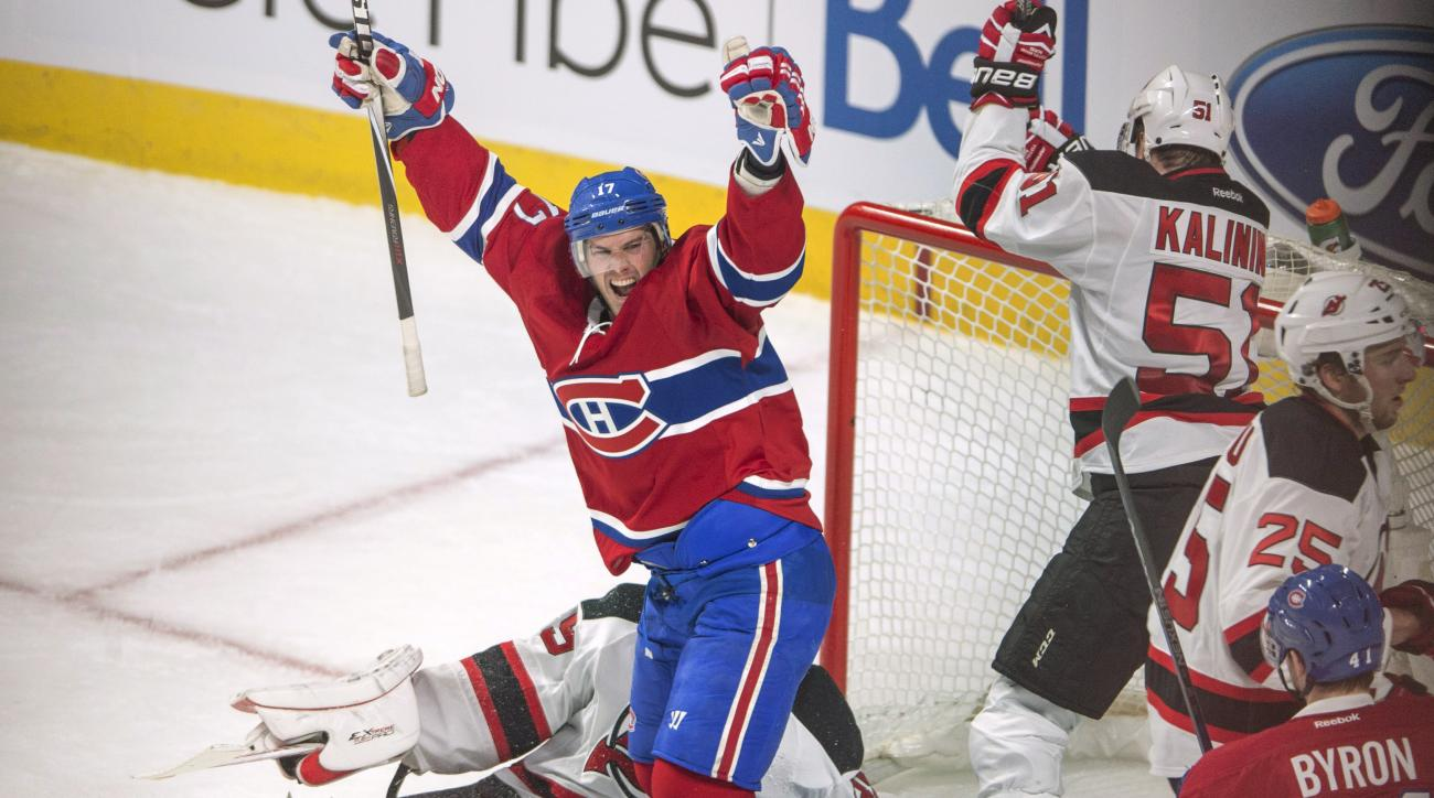 Montreal Canadiens center Torrey Mitchell (17) celebrates after scoring against New Jersey Devils goalie Cory Schneider (35) during the second period of an NHL hockey game Wednesday, Jan. 6, 2016, in Montreal. (Ryan Remiorz/The Canadian Press via AP)