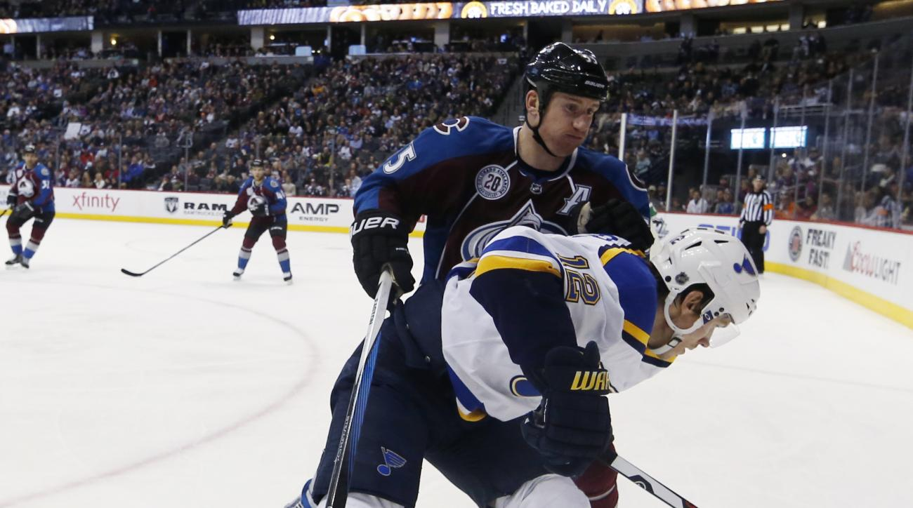 St. Louis Blues center Jori Lehtera, front, of Finland, and Colorado Avalanche left wing Cody McLeod compete for the puck during the second period of an NHL hockey game  Wednesday, Jan. 6, 2016, in Denver. (AP Photo/David Zalubowski)