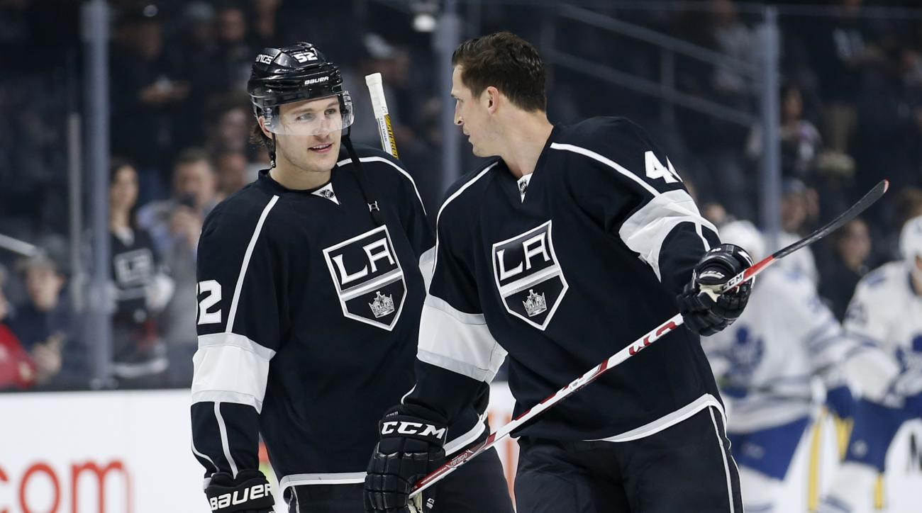 Newly acquired Los Angeles defenseman Luke Schenn, left, and center Vincent Lecavalier talk as players warm up for an NHL hockey game against the Toronto Maple Leafs, Thursday, Jan. 7, 2016, in Los Angeles. The Kings acquired Schenn and Lecavalier from Ph