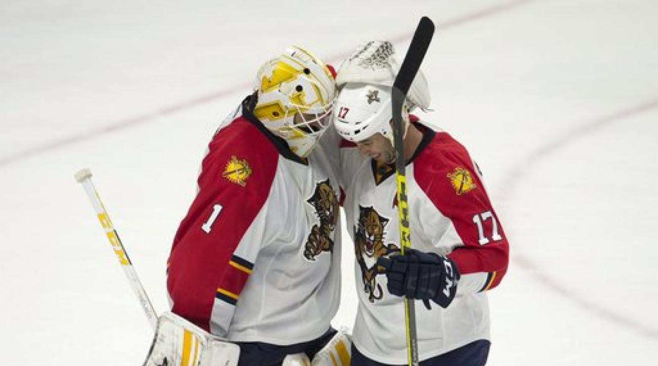 Florida Panthers goalie Roberto Luongo celebrates with center Derek MacKenzie after an NHL hockey game against the Ottawa Senators on Thursday, Jan. 7, 2015, in Ottawa, Ontario. (Adrian Wyld/The Canadian Press via AP)