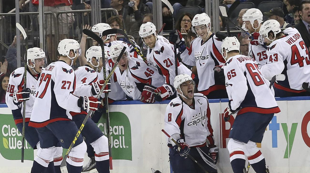 Washington Capitals left wing Alex Ovechkin (8) celebrates with his teammates after scoring the game-winning goal during overtime of an NHL hockey game against the New York Rangers, Saturday, Jan. 9, 2016, at Madison Square Garden in New York. The Capital