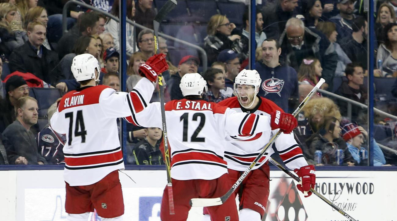 Carolina Hurricanes' Jordan Staal, right, celebrates his game-winning goal against the Columbus Blue Jackets during the third period of an NHL hockey game Saturday, Jan. 9, 2016, in Columbus, Ohio. The Hurricanes beat the Blue Jackets 4-3 in overtime. (AP