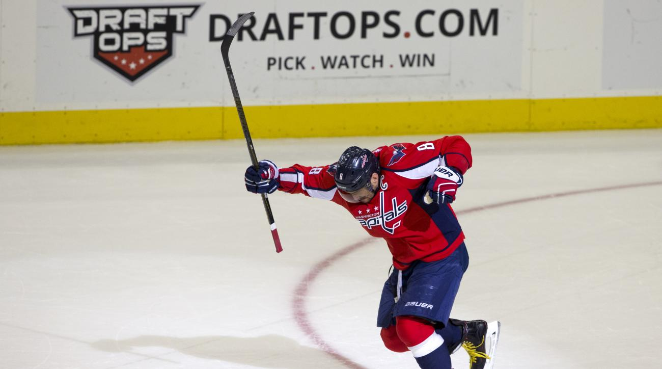 Washington Capitals left wing Alex Ovechkin (8) celebrates just after scoring his 500th career goal during the second period of a NHL hockey game against the Ottawa Senators in Washington, D.C., Sunday, Jan. 10, 2016. (AP Photo/Jacquelyn Martin)