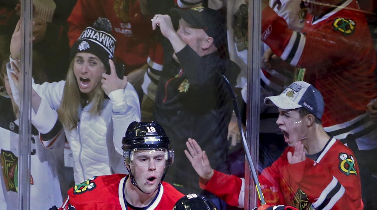 Chicago Blackhawks center Jonathan Toews (19) celebrates with center Andrew Shaw (65) after scoring against the Colorado Avalanche during the second period of an NHL hockey game Sunday, Jan. 10, 2016, in Chicago. (AP Photo/Kamil Krzaczynski)