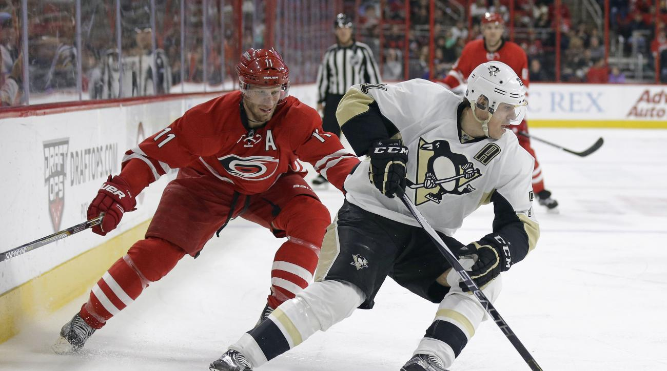 Carolina Hurricanes' Jordan Staal (11) chases Pittsburgh Penguins' Evgeni Malkin (71), of Russia, during the second period of an NHL hockey game in Raleigh, N.C., Tuesday, Jan. 12, 2016. (AP Photo/Gerry Broome)