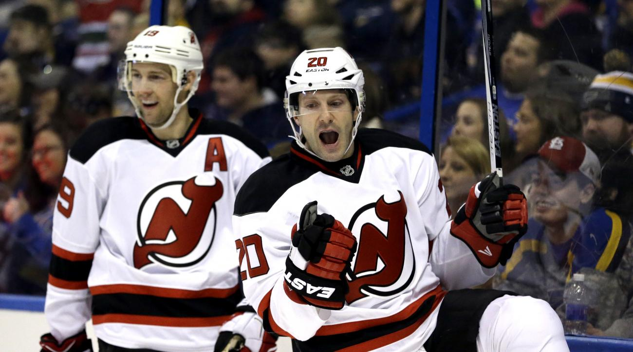 New Jersey Devils' Lee Stempniak, right, celebrates alongside teammate Travis Zajac after scoring during the first period of an NHL hockey game against the St. Louis Blues, Tuesday, Jan. 12, 2016, in St. Louis. (AP Photo/Jeff Roberson)
