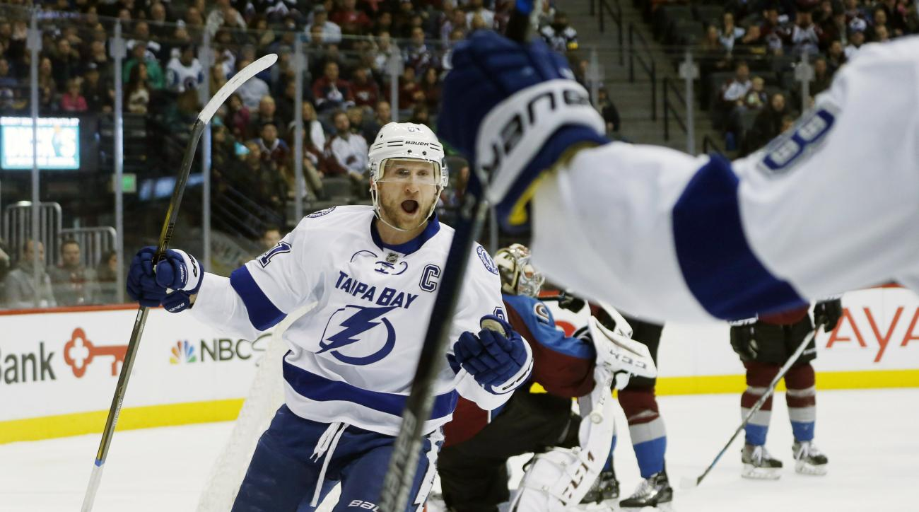 Tampa Bay Lightning center Steven Stamkos, back, reacts after scoring a goal on pass from left wing Ondrej Palat, front, of the Czech Republic, against he Colorado Avalanche in the second period of an NHL hockey game, Tuesday, Jan. 12, 2016, in Denver. (A