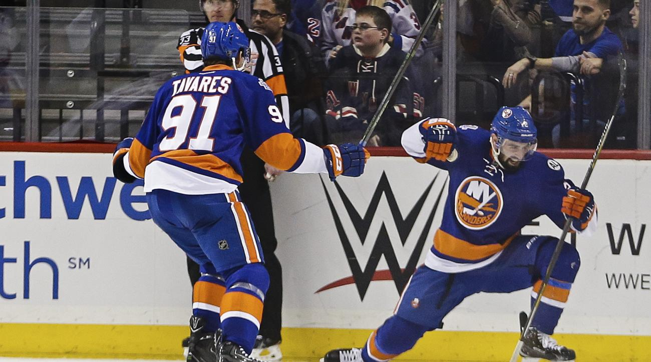 New York Islanders' Nick Leddy (2) and John Tavares (91) celebrate a goal by Leddy during the third period of an NHL hockey game against the New York Rangers, Thursday, Jan. 14, 2016, in New York. The Islanders won 3-1. (AP Photo/Frank Franklin II)
