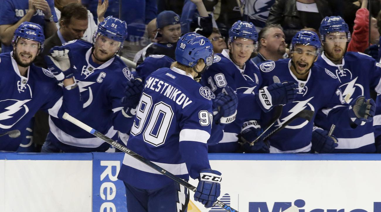 Tampa Bay Lightning center Vladislav Namestnikov (90), of Russia, celebrates with players on the bench after scoring against the Pittsburgh Penguins during the second period of an NHL hockey game Friday, Jan. 15, 2016, in Tampa, Fla. (AP Photo/Chris O'Mea