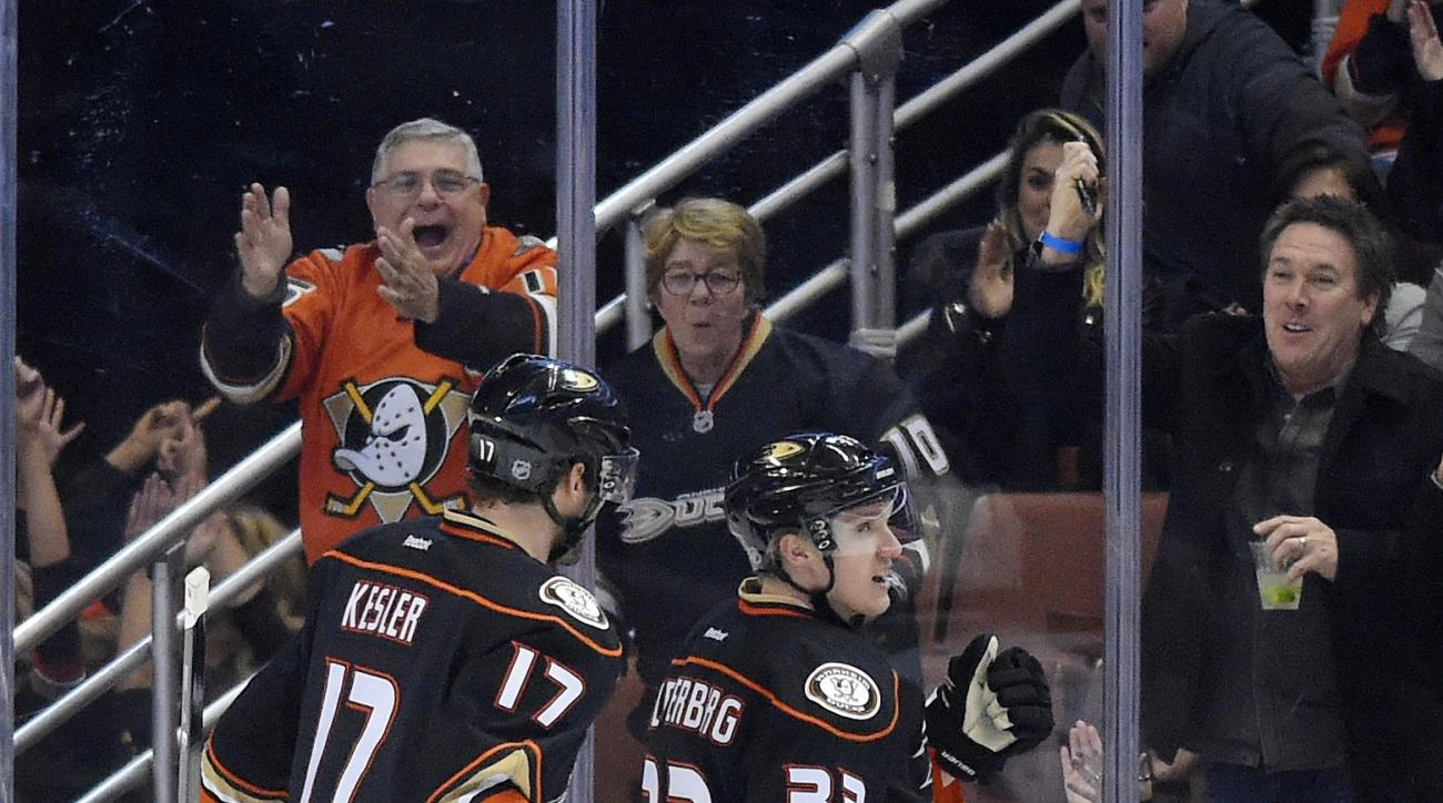 Anaheim Ducks left wing Jakob Silfverberg, right, of Sweden, celebrates his goal with center Ryan Kesler during the first period of an NHL hockey game against the Dallas Stars, Friday, Jan. 15, 2016, in Anaheim, Calif. (AP Photo/Mark J. Terrill)