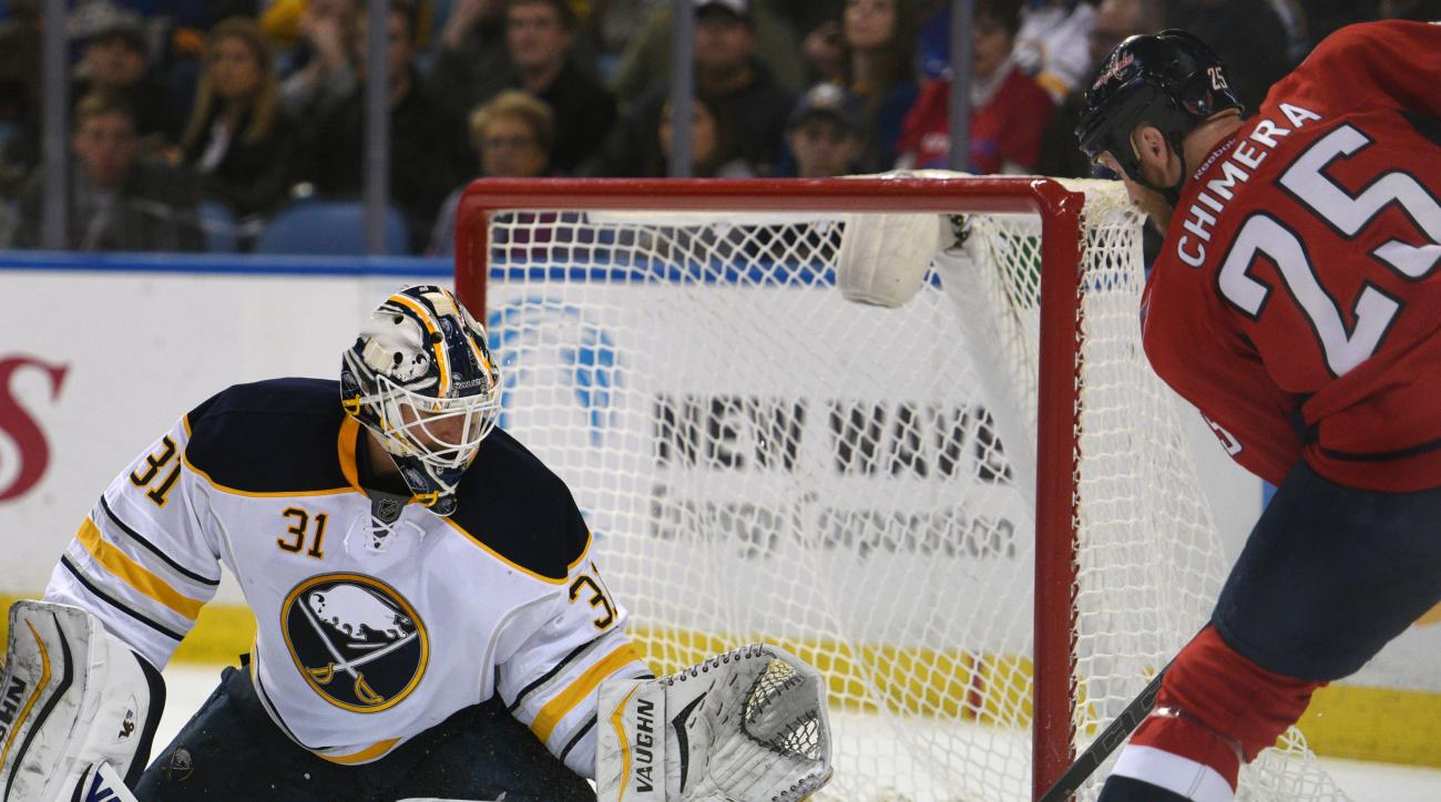 Buffalo Sabres goaltender Chad Johnson (31) makes a save on Washington Capitals left winger Jason Chimera (25) during the second period of an NHL hockey game, Saturday, Jan. 16, 2016 in Buffalo, N.Y. (AP Photo/Gary Wiepert)