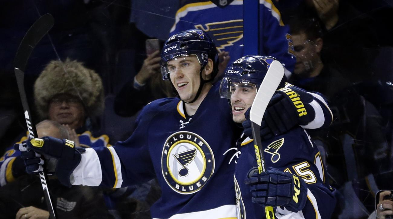 St. Louis Blues' Jori Lehtera, of Finland, is congratulated by Robby Fabbri, right, after scoring the game-winning goal during overtime of an NHL hockey game against the Montreal Canadiens Saturday, Jan. 16, 2016, in St. Louis. The Blues won 4-3. (AP Phot