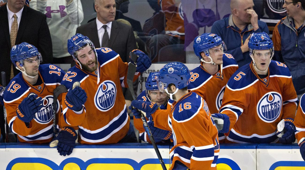 Edmonton Oilers' Teddy Purcell (16) celebrates his shootout goal against the Calgary Flames during an NHL hockey game in Edmonton, Alberta, Saturday, Jan. 16, 2016. (Jason Franson/The Canadian Press via AP) MANDATORY CREDIT