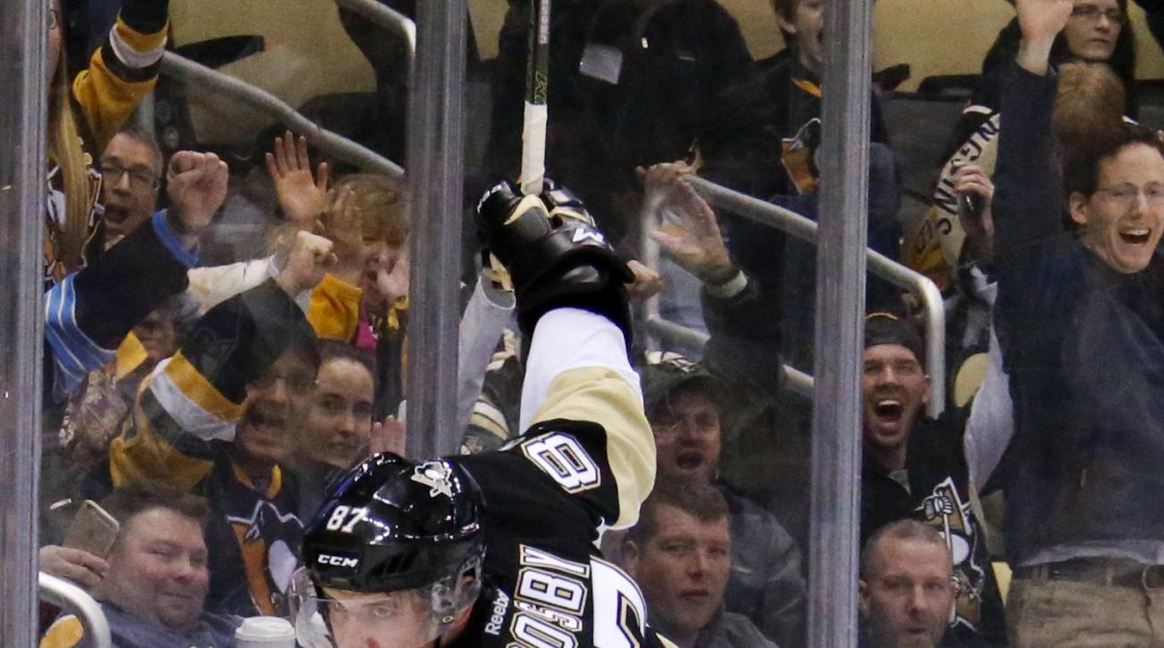 Pittsburgh Penguins' Sidney Crosby celebrates his goal during the second period of an NHL hockey game against the Carolina Hurricanes in Pittsburgh, Sunday, Jan. 17, 2016. (AP Photo/Gene J. Puskar)