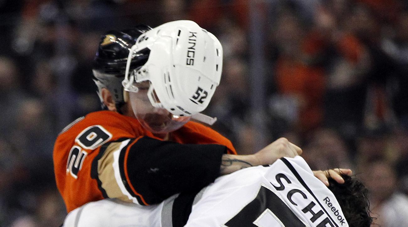 Los Angeles Kings defenseman Luke Schenn's (52) helmet flies off in a fight against Anaheim Ducks right wing Chris Stewart (29) during the second period of an NHL hockey game in Anaheim, Calif., Sunday, Jan. 17, 2016. (AP Photo/Alex Gallardo)