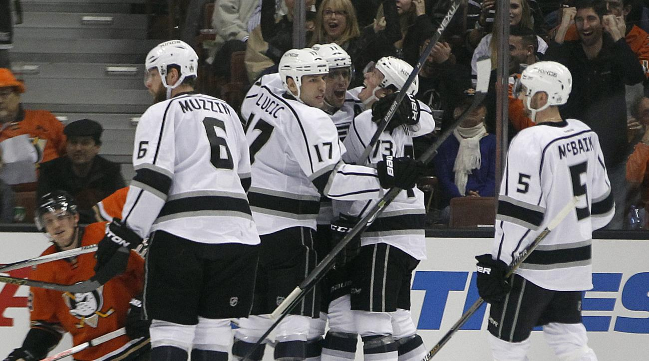 Los Angeles Kings left wing Milan Lucic (17) and center Anze Kopitar, center, of Slovenia, celebrate a goal by center Tyler Toffoli, second from right, with defenseman Jake Muzzin (6) and Jamie McBain (5) looking on against the Anaheim Ducks during the se