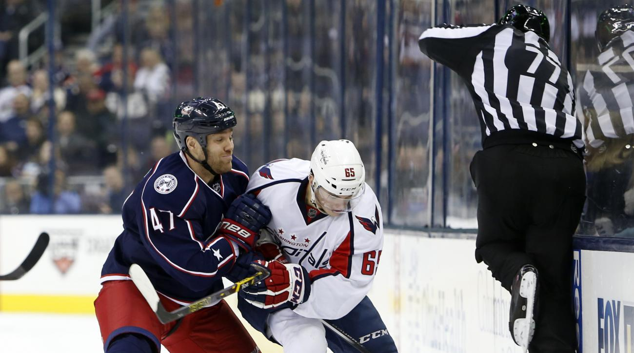 Washington Capitals' Andre Burakovsky, right, of Austria, and Columbus Blue Jackets' Dalton Prout fight for a loose puck during the third period of an NHL hockey game, Tuesday, Jan. 19, 2016, in Columbus, Ohio. The Capitals defeated the Blue Jackets 6-3.
