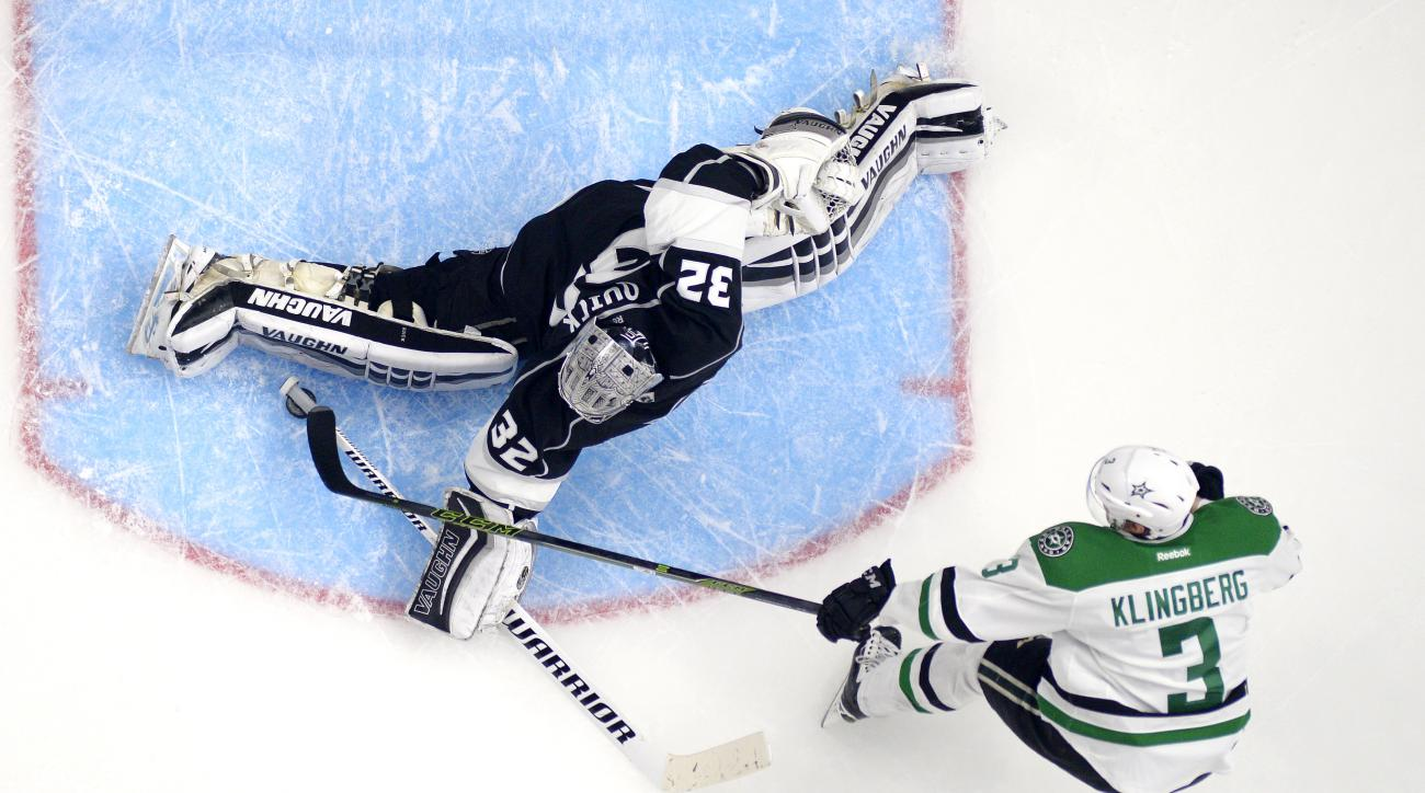 Dallas Stars defenseman John Klingberg, right, of Sweden, shoots on Los Angeles Kings goalie Jonathan Quick during the second period of an NHL hockey game Tuesday, Jan. 19, 2016, in Los Angeles. (AP Photo/Mark J. Terrill)