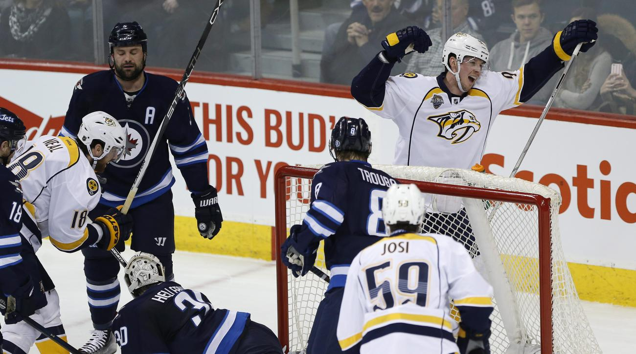 Nashville Predators' Ryan Johansen (92) celebrates his goal against Winnipeg Jets goaltender Connor Hellebuyck (30) during the first period of an NHL hockey game Thursday, Jan. 21, 2016, in Winnipeg, Manitoba. (John Woods/The Canadian Press via AP)