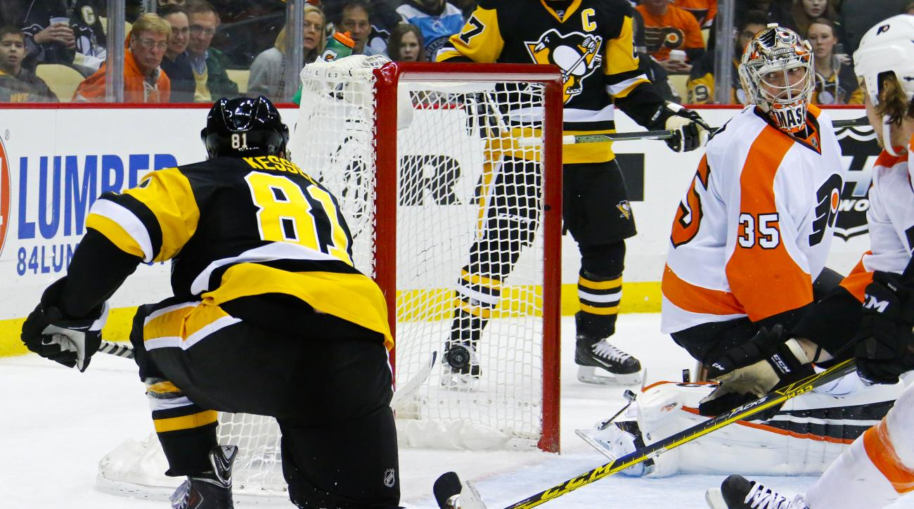 Pittsburgh Penguins' Phil Kessel (81) puts the puck behind Philadelphia Flyers goalie Steve Mason (35) for a goal during the second period of an NHL hockey game against the Philadelphia Flyers in Pittsburgh, Thursday, Jan. 21, 2016. (AP Photo/Gene J. Pusk