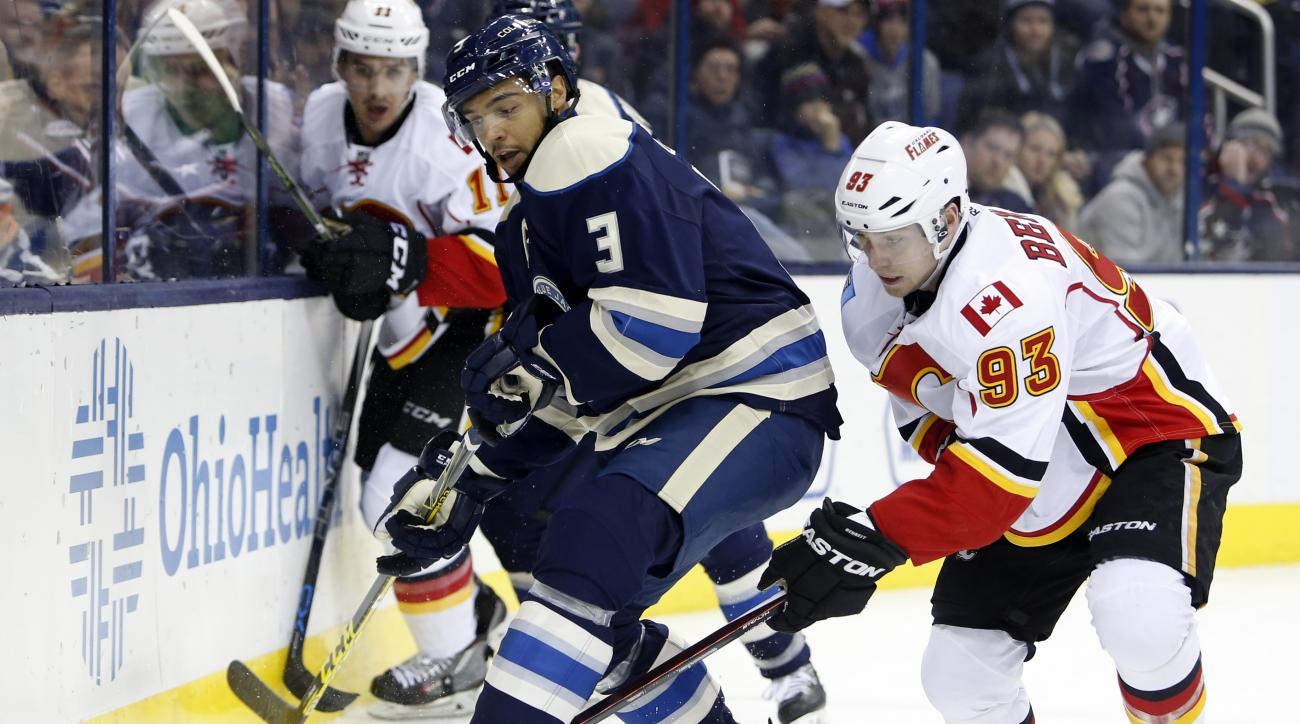 Calgary Flames' Sam Bennett, right, tries to steal the puck from Columbus Blue Jackets' Seth Jones during the second period of an NHL hockey game Thursday, Jan. 21, 2016, in Columbus, Ohio. The Flames beat the Blue Jackets 4-2. (AP Photo/Jay LaPrete)